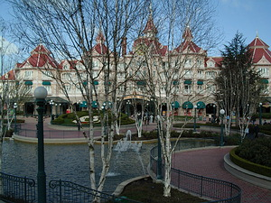 Disneyland Hotel and the park entrance, seen through the entrance plaza trees