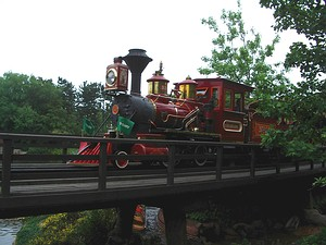 Western River Railroad passing over the trestle above the outdoor dining area.